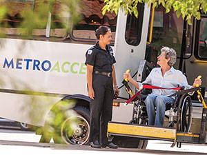 section1-MetroAccess-vehicle-operator-assisting-wheelchair-customer-de-boarding