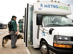 section2-customer-with-a-service-animal-boarding-MetroAccess-bus