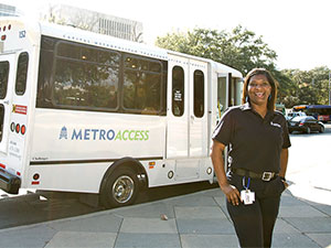 section7-MetroAccess-vehicle-operator-with-her-vehicle-in-the-background