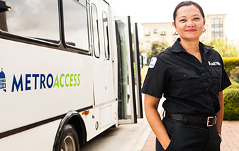 section9-MetroAccess-vehicle-operator-with-a-MetroAccess-mini-van-in-the-background